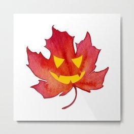Jack-o-lantern face on a Fall Maple Leaf Metal Print