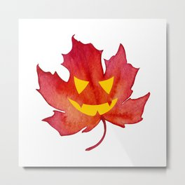 Jack-o-lantern face on a Fall Maple Leaf Metal Print