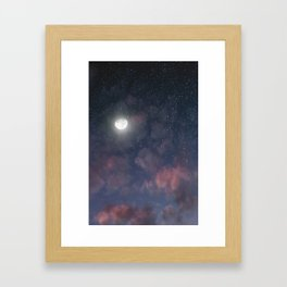 Glowing Moon on the night sky through pink clouds Framed Art Print