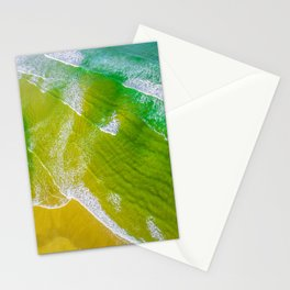 Aerial view looking down at turquoise ocean waves and sandy beach Stationery Cards