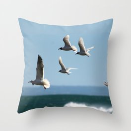 Seagulls flying over the sea Throw Pillow