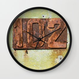 Old entrance door with the number 102 Wall Clock