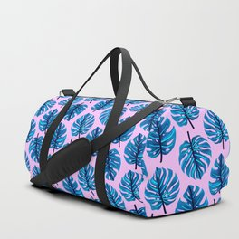 Blue monstera leaves pattern on pink background Duffle Bag