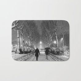 Strangers in the snow Bath Mat
