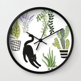Black cat and plants in the pots. Morning stretch Wall Clock