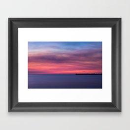 Red sunset over the ocean Framed Art Print