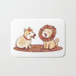 Corgi dog and a cat imitating lion with mane made of autumn leaves Bath Mat