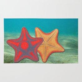 Vintage sketch of sea stars on blue Rug