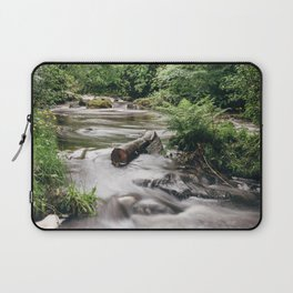 Driftwood in flowing river near Ullswater. Cumbria, UK. Laptop Sleeve