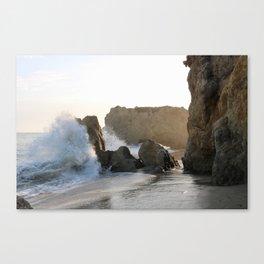 Wave crashing on rocky beach Canvas Print