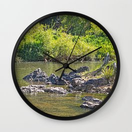 Beautiful rocks in the tranquil river Wall Clock