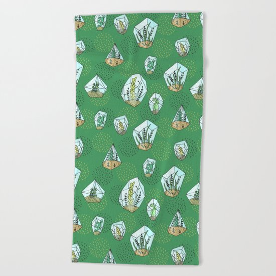 Green succulents in the glass vase Beach Towel