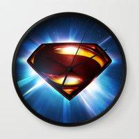 man of steel Wall Clocks featuring Man of Steel Logo by taylorwayne93