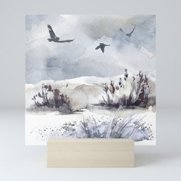 Soaring Above Sandy Beaches Against Stormy Skies Mini Art Print