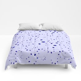 A lot of blue drops and petals on a cloudy background in nacre. Comforters