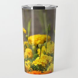 Lovely butterfly on yellow flower, with field of carnations on background Travel Mug