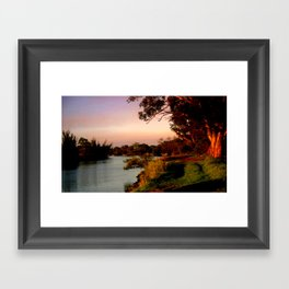 Reflecting sunset on the river Bank Framed Art Print