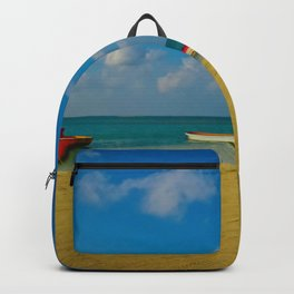 Colorful Boats Adorn the Tranquil Beach Backpack
