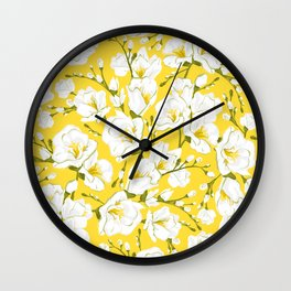 White freesia on a yellow background Wall Clock