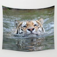 swimming Wall Tapestries featuring Swimming tiger by jamfoto