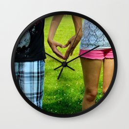 Makers of Love- A couple making a heart with their hands Wall Clock