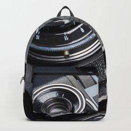 Vintage rangefinder camera and rolls color negative film Backpack