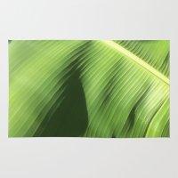 banana leaf Area & Throw Rugs featuring Banana Leaf by Glenn Designs