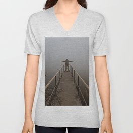 Man with open arms on a frozen pier shrouded in mist Unisex V-Neck