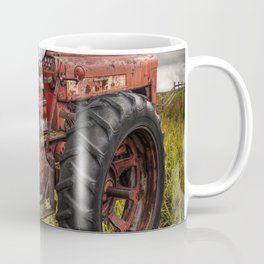 Abandoned Old Farmall Tractor in a Grassy Field on a Farm Coffee Mug