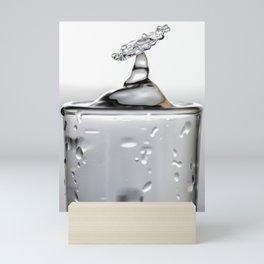 Cold shot glass drop Mini Art Print