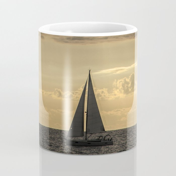 Sailboat Sailing in Lake Michigan beneath Sunbeams Coffee Mug