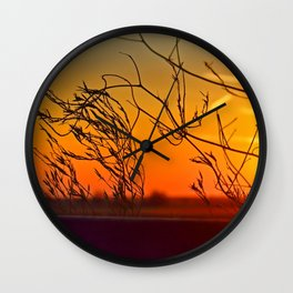 Sunset through the bushes Wall Clock