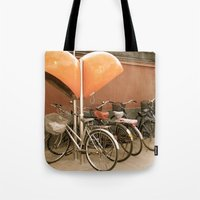 bikes Tote Bags featuring Bikes, bikes, bikes by Anything et Everything by Nina L.