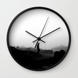 a man and fog Wall Clock