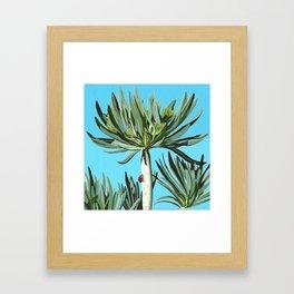 Ladybug on exotic plant Framed Art Print