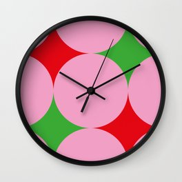 Pink balls hiding a beautiful red and green carpet. Or red and green stars in a pink Space ? Wall Clock