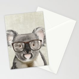 A baby koala with glasses on a rustic background Stationery Cards