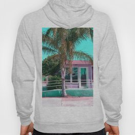 pink building in the city with palm tree and blue sky Hoody