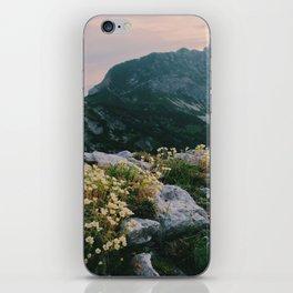 Mountain flowers at sunrise iPhone Skin