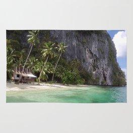Pinagbuyutan Island with emerald water Rug