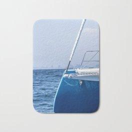 A Catamaran Edge Sleeps in the Ocean Blue Bath Mat
