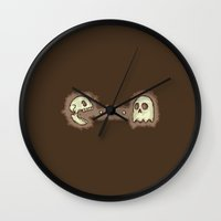 pac man Wall Clocks featuring Dead Pac-Man by Adel