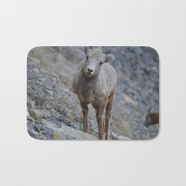 Big horn lamb learns the way of the rock Bath Mat