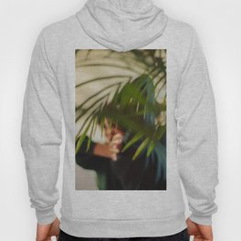 Dancer, woman behind plants, blur Hoody