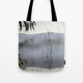 """Dream trees"". Foggy sunrise at the lagoon Tote Bag"