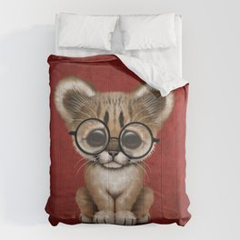 Cute Cougar Cub Wearing Reading Glasses on Red Comforters