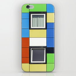 Facade with colorful paintings and windows iPhone Skin