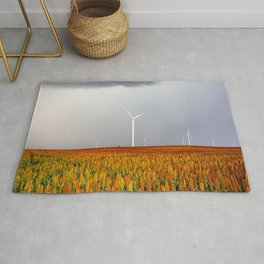 Maizy Day - Colorful Maize and Wind Turbines on Stormy Day in Kansas Rug