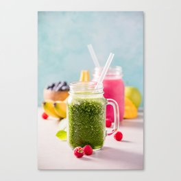 Close-up of green fresh smoothie with fruits, berries, oats and seeds, selective focus Canvas Print
