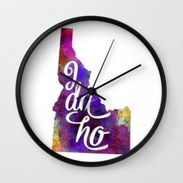 Idaho US State in watercolor text cut out Wall Clock